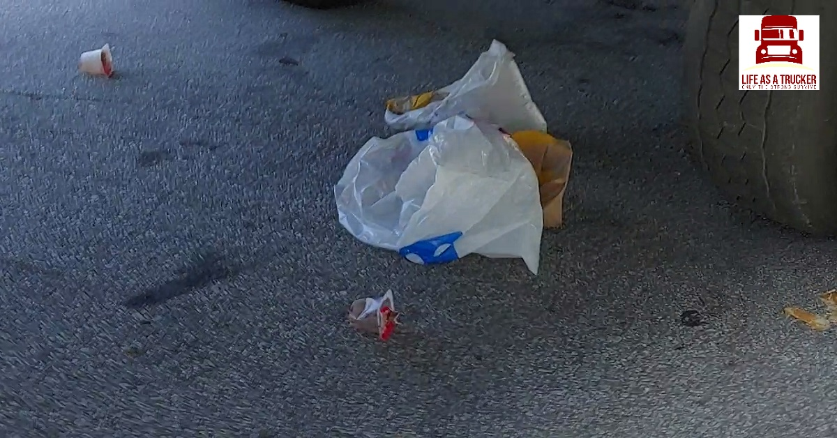 This person is an idiot.  Don't be like this trucker who throws trash on the ground where he/she parks.