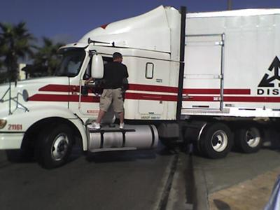 My husband helping another trucker get unstuck from the middle of A1A in Florida.