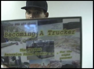 me holding the becoming a trucker dvd