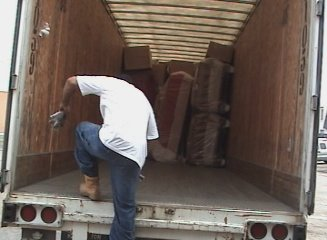 Paid to exercise. The crazy trucker unloading furniture.